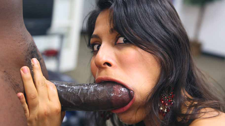 Latin slut sucking a big chocolate bar